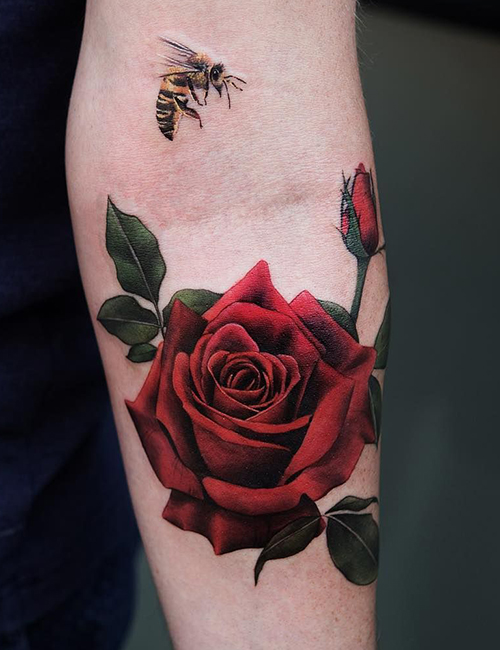 Red rose tattoos on Arm