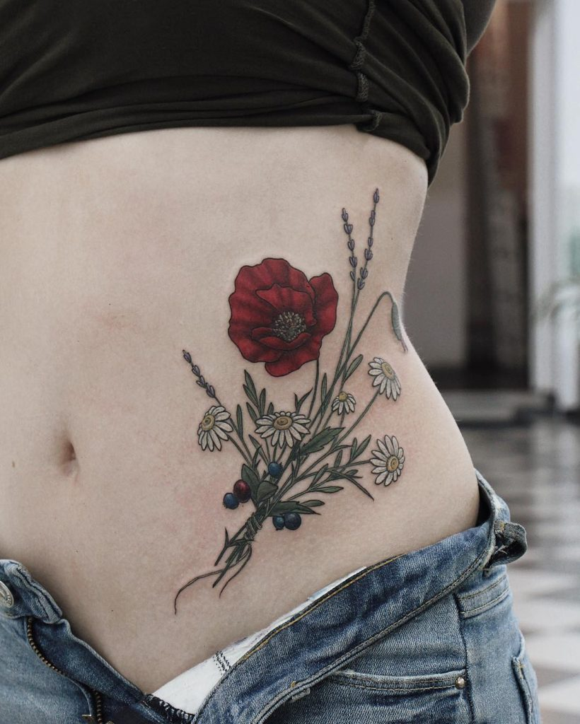 Red wildflower tattoo on the belly