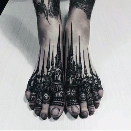 Buildings with pointed towers tattoo on foot for males