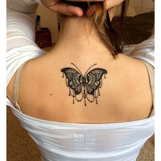 A butterfly tattoo with a chandelier