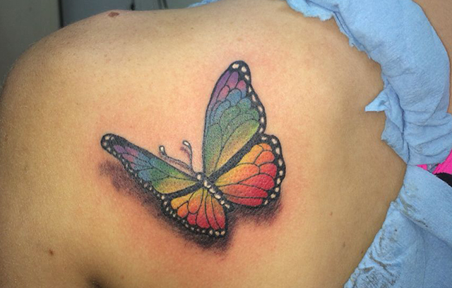 Butterfly rainbow tattoo