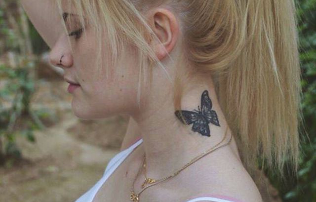 beautiful Butterfly tattoo on neck