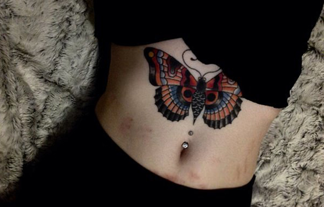 3575fe8e50d16 This one you can get done on your side belly it goes upwards towards your  chest. The tattoo features regular and shadowy butterflies in an evil black  swirl, ...