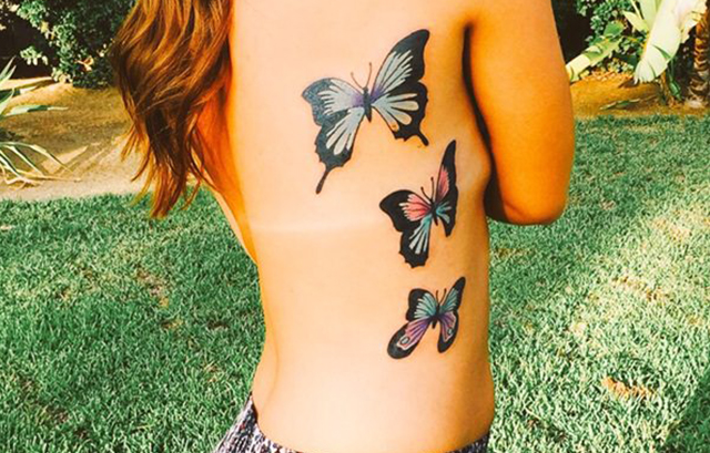 Gilr's side butterfly tattoo