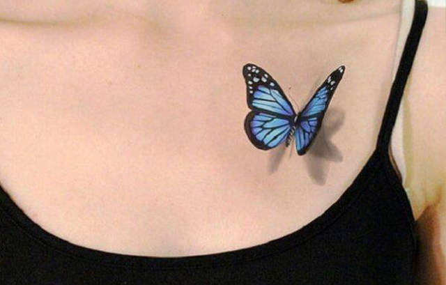 Simple butterfly tattoo on girl's chest