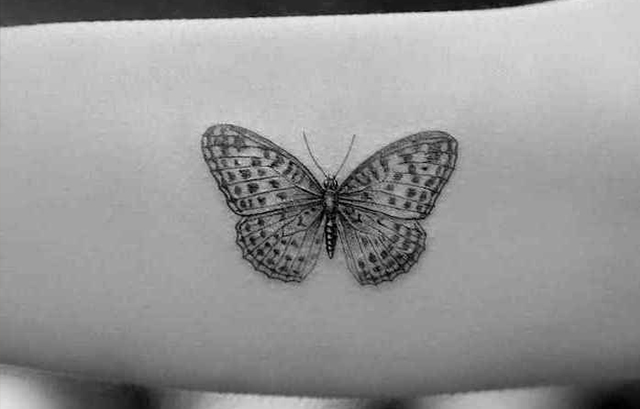 Small black butterfly tattoo