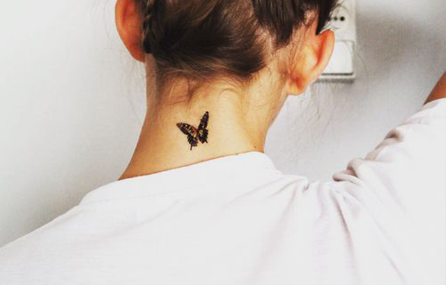 small butterfly nape tattoo