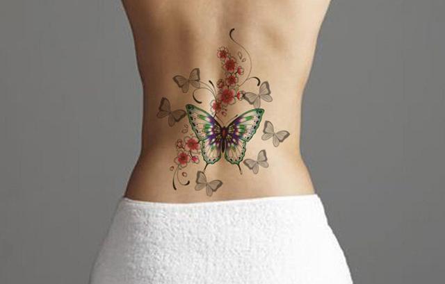 butterfly tattoo on women's back