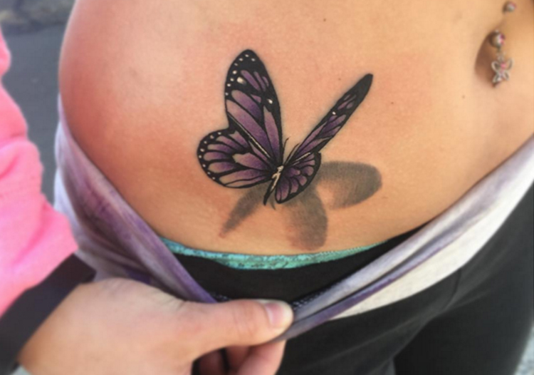 Butterfly tattoo on tummy