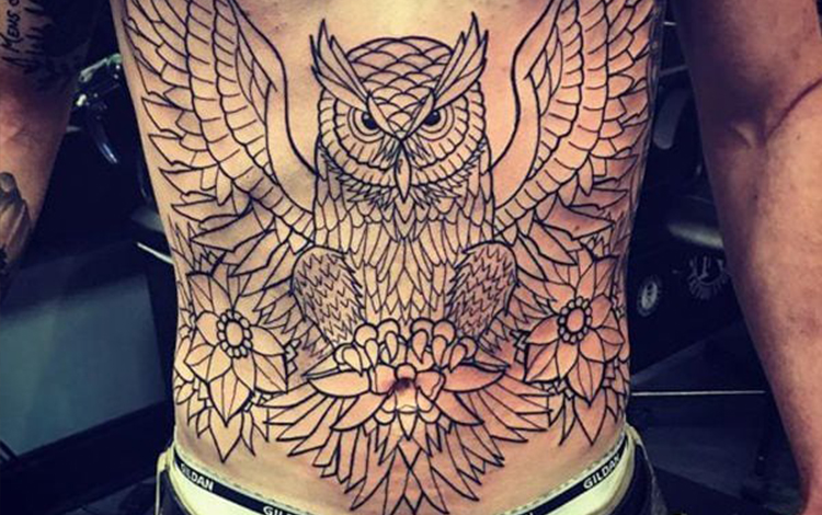 Owl tattoo on stomach