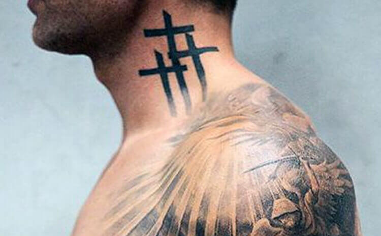 Cross tattoo on nape