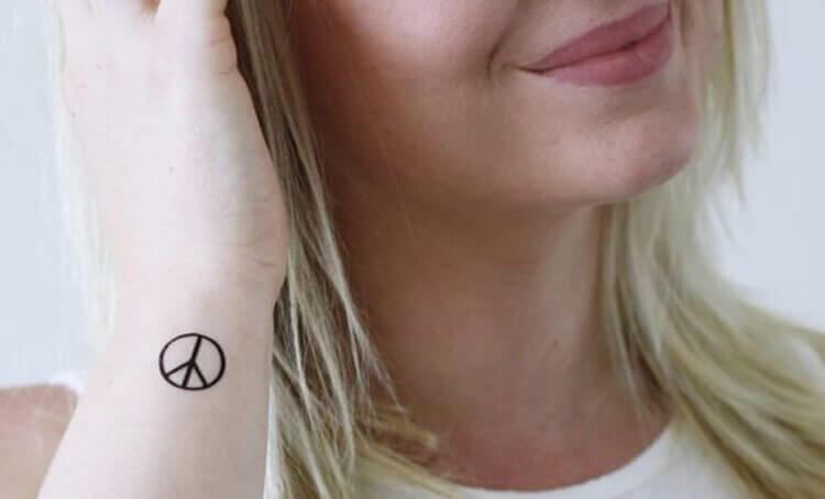 Small Peace Symbol Tattoo