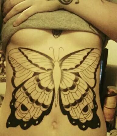 Giant Butterfly tattoo on tummy