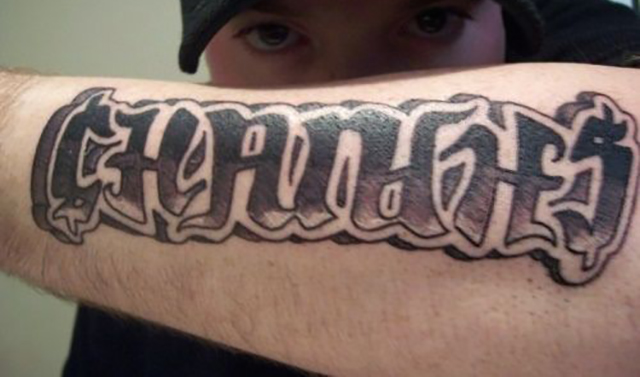 'Changes' in graffiti font on forearm ambigram tattoo