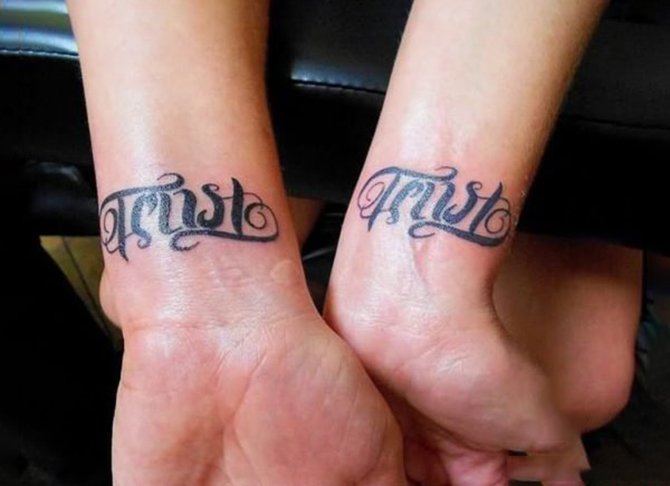 Ambigram tattoo on wrist