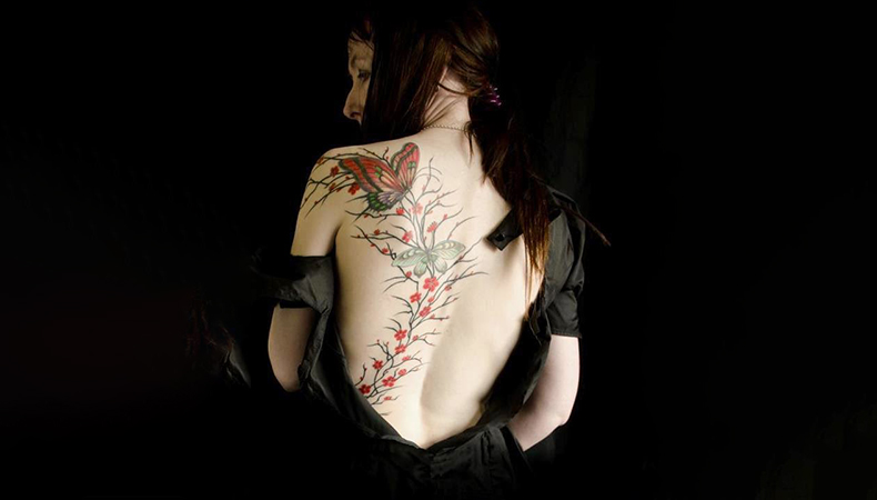 Butterfly leaf tattoo on back