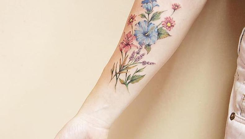 flower inner arm tattoo