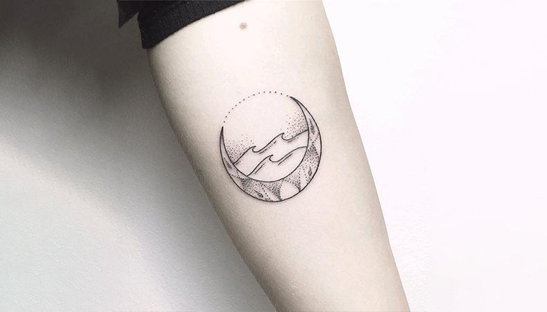 Moon tattoo on hand