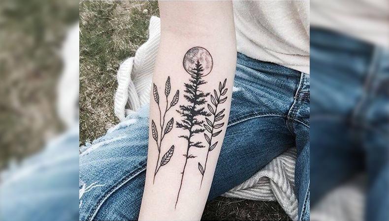 Tree, leaves, and moon tattoo