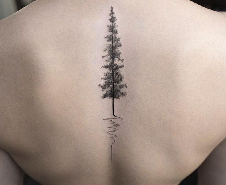 tree tattoo on spine