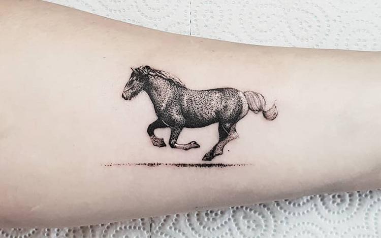 Running Horse Tattoo on Forearm