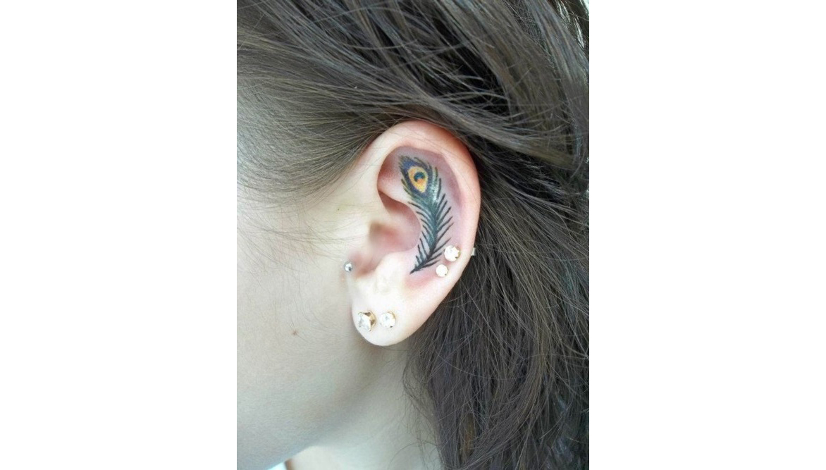 Peacock feather tattoo on ear