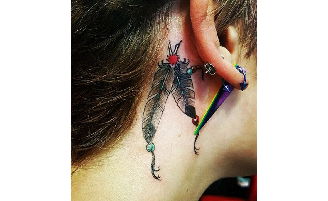 Twin feather tattoos