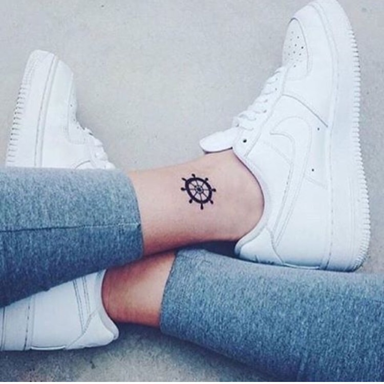 Wheel tattoo on ankle