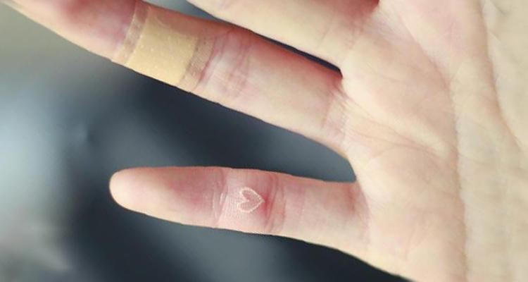 White heart Tattoo on Finger