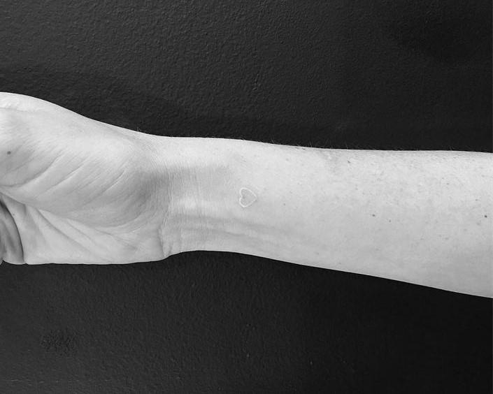White Heart tattoo on forearm