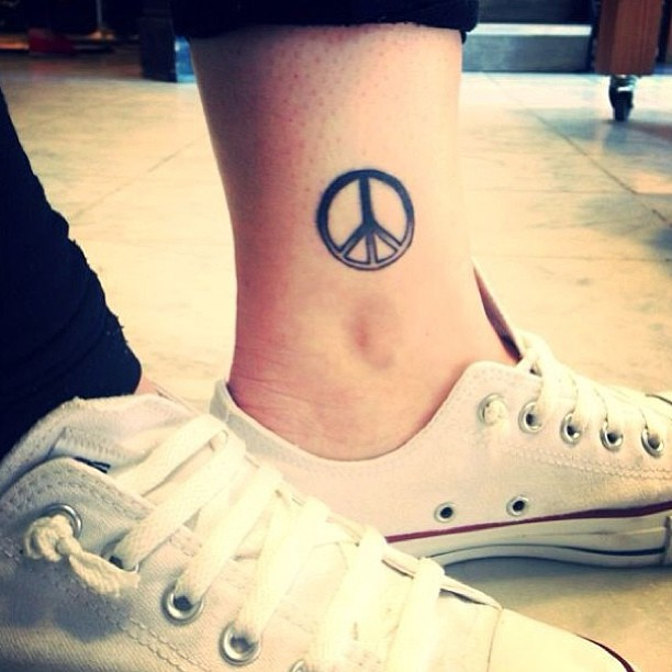 Peace Symbol tattoo on ankle