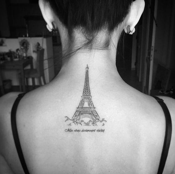 Eiffel Tower tattoo on girl's back