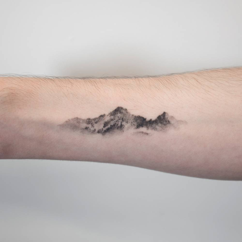 Small Mountain tattoo designs on wrist