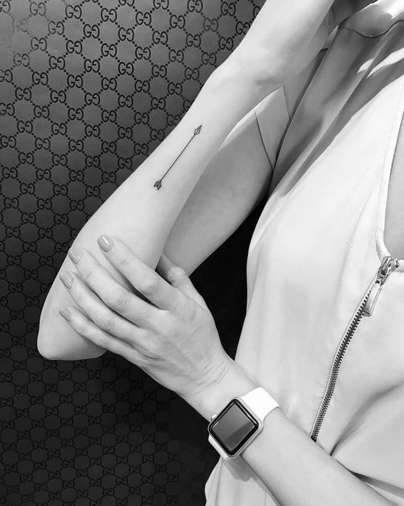 Small Arrow Tattoo idea for girl