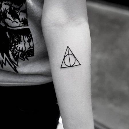 Small Hallow Symbol Tattoo