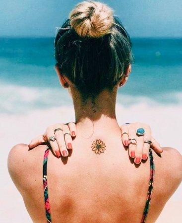 Small Sunflower Tattoo on back