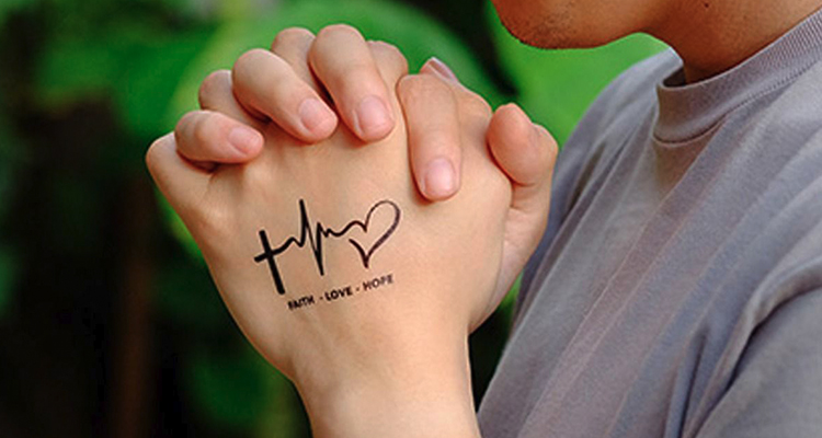 'FAITH HOPE LOVE' on your hand tattoo