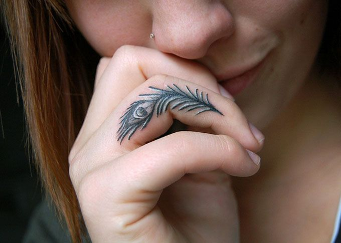 peacock feather finger tattoos for men and women