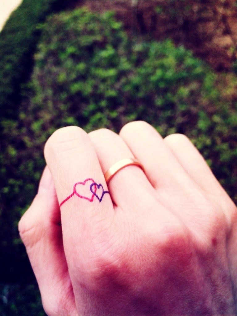 Double heart finger tattoos for girl