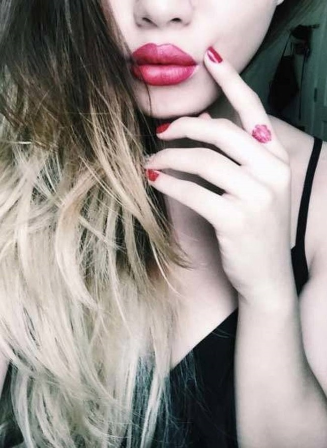 Lips finger tattoos