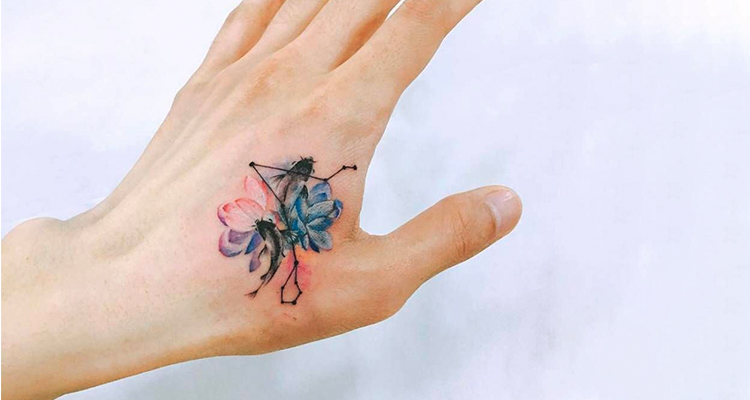 Pisces fish on your hand tattoo