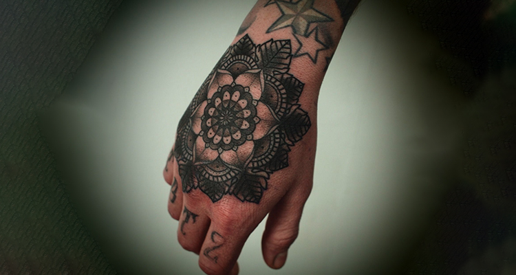 intricate mandala on your hand tattoo
