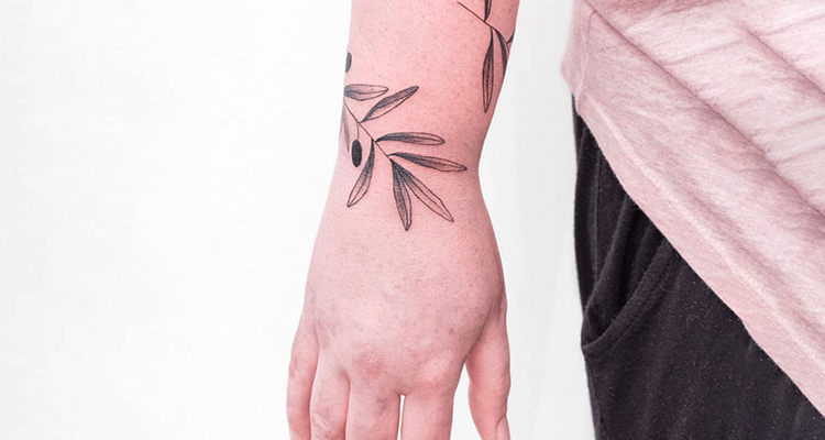 olive branch on your hand tattoo