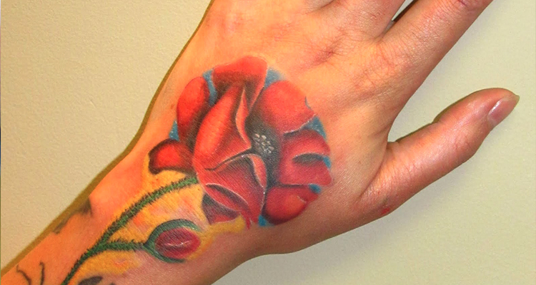 poppy flower on your hand tattoo