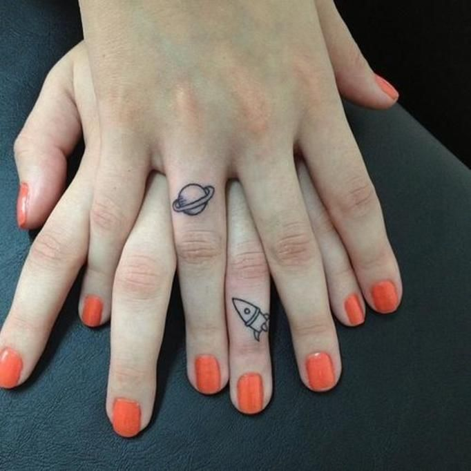 space finger tattoo