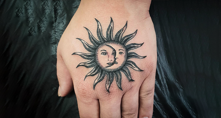 sun on your hand tattoo