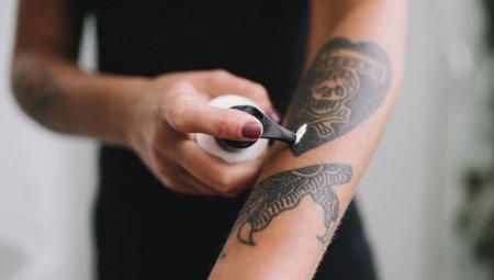 Applying moisturizer on tattoo