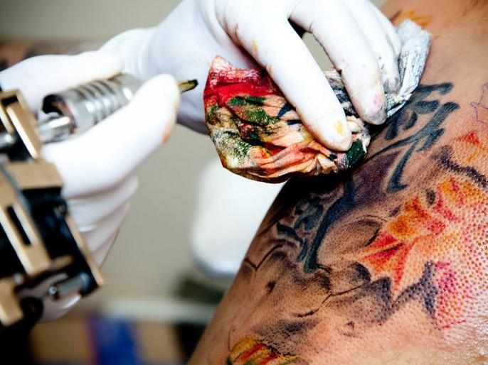 Excess Bleeding blood after getting tattoo
