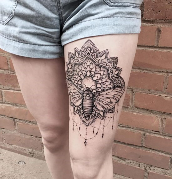 Intricate Mandala Tattoo designs on leg
