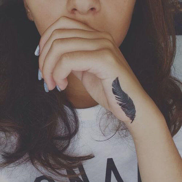Best Feather Hand Tattoos